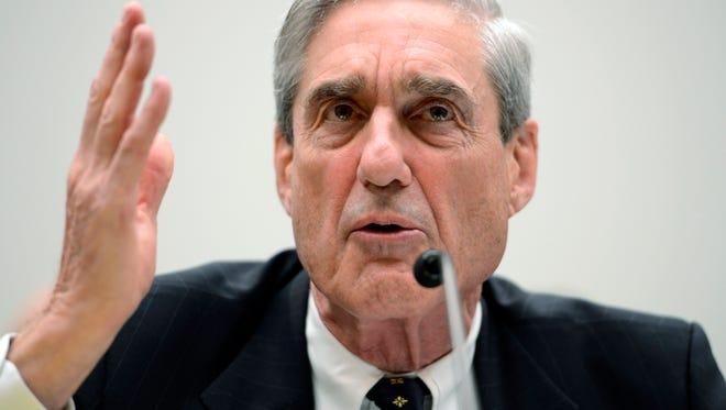 Former FBI director Robert Mueller testifies before the House Judiciary Committee in Washington, June 13, 2013.