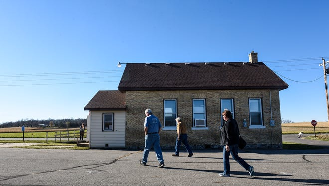 People walk to the polling place to cast their votes Tuesday, Nov. 8,  at the St. Wendel Township Hall.