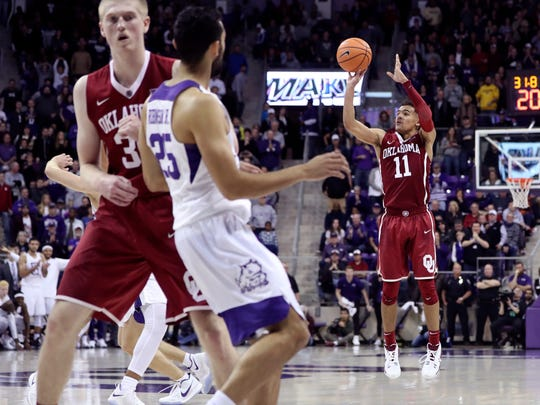 Oklahoma guard Trae Young shoots during the second