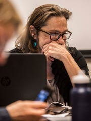 Burlington School Board acting Chairwoman Stephanie Seguino listens to board member Jeff Wick complain that an emergency meeting held Sunday night, April 1, 2018, was illegal.