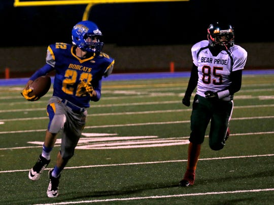 Bloomfield's Chauncey White (22) runs with the ball on Friday during a game against Wingate at Bobcat Stadium in Bloomfield.