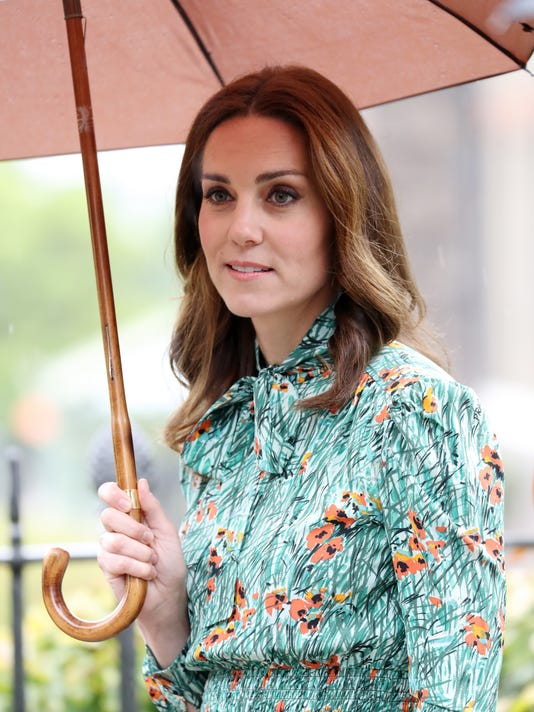 58f74e06c8 Duchess Kate  French court to rule in topless paparazzi case