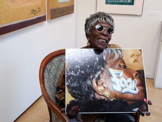 Thelma Jenkins, 95, holds the photo created by her