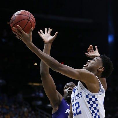 Kentucky's Shai Gilgeous-Alexander goes up against