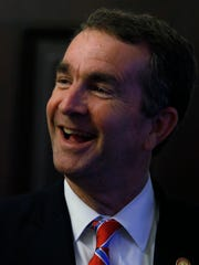 Virginia Gov. Ralph Northam reacts to the House and