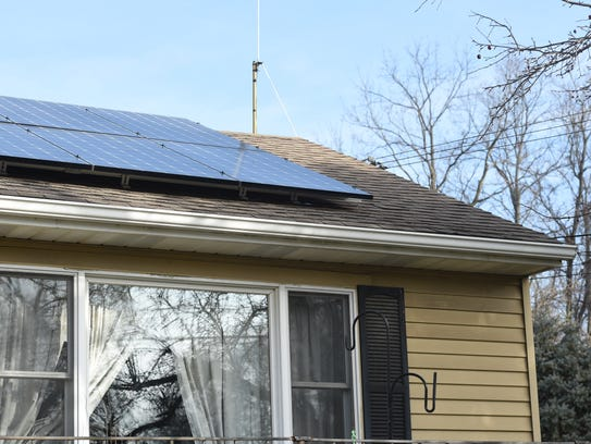 The solar panels on the roof of the Cohns' home in