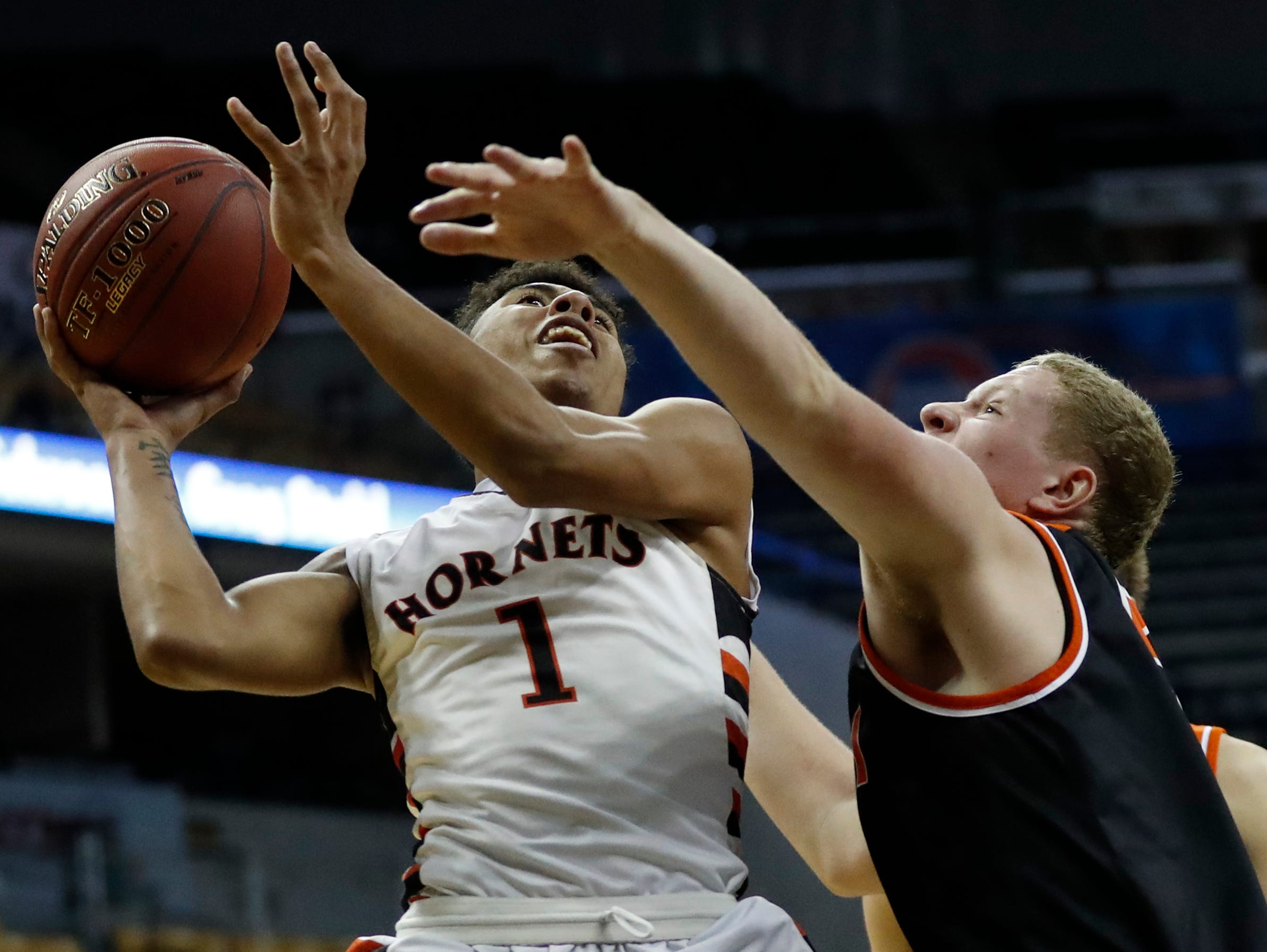 Advance's Armani Vermillion, left, shoots over Walnut Grove's Cole Melton during the second half of the Missouri Class 1 boys high school championship basketball game Saturday, March 11, 2017, in Columbia, Mo. Walnut Grove won 65-62. (AP Photo/Jeff Roberson)