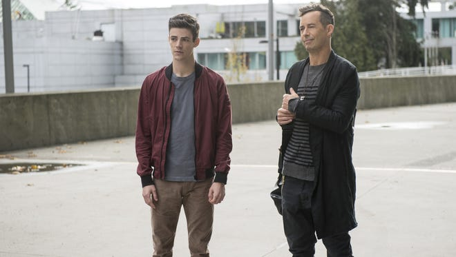 Grant Gustin as Barry Allen and Tom Cavanagh as Harrison Wells in the CW's 'The Flash.'