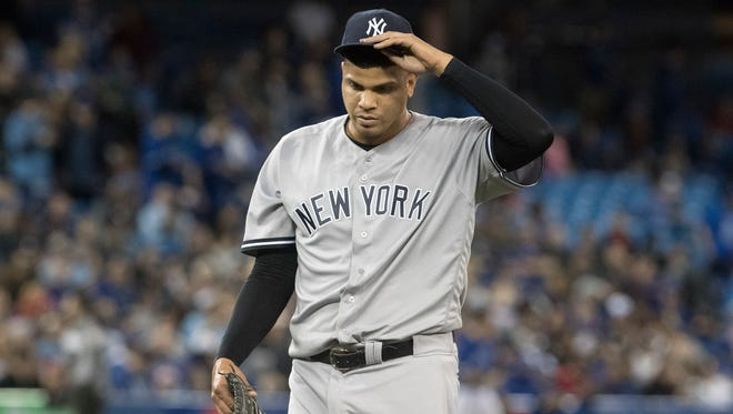 Dellin Betances yielded five hits and three runs in the eighth inning Friday against the Tigers.