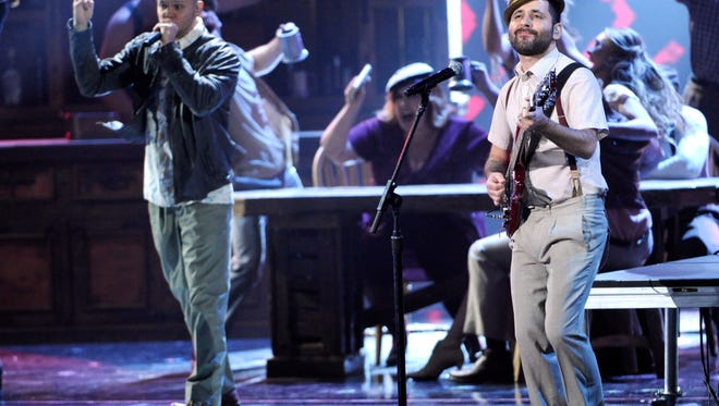 """Rene Perez Joglar, left, and Eduardo """"Visitante"""" Cabra, of the musical group Calle 13, perform on stage at the 15th annual Latin Grammy Awards at the MGM Grand Garden Arena on Thursday, Nov. 20, 2014, in Las Vegas."""