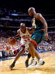 NBA veteran Vincent Askew is coming to Guam to launch the Jr. NBA Guam experience in the 2017 Holiday Youth Camp at Tamuning Gym on December 26 to29 sponsored by TakeCare and FHP. Visit www.guambasketball.com for info and to register. Pictured is Askew, right, with the Seattle Super Sonics in the 96 finals playing against Chicago Bulls Michael Jordan.