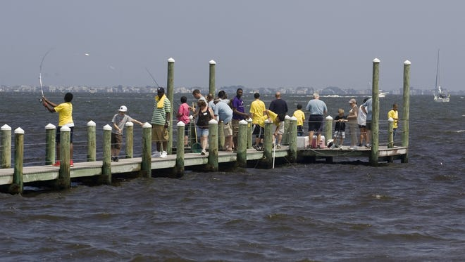 Ocean Township (Waretown), NJ- 06/25/11- The Forked River Angelers Club hosts a day of fishing for members of Ocean County Big Brothers and Big Sisters at the Lighthouse Center for Natural Resources.  DOUG HOOD/STAFF PHOTOGRAPHER