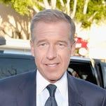"""News anchor Brian Williams attends Universal Pictures' """"Neighbors"""" premiere at Regency Village Theatre on April 28, 2014, in Westwood, Calif."""