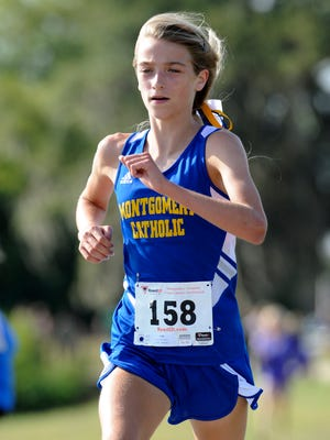 Catholic runner Amaris Tyynismaa finishes first in the Montgomery Academy Cross Country Invitational meet on Saturday September 26, 2014 at Gateway Park in Montgomery, Ala.