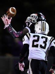 Pearl-Cohn wide receiver Darius Hunter Jr. (17) pulls in a pass over Springfield free safety Dayron Johnson (23) during their game Friday Oct. 30, 2015, in Nashville, Tenn.