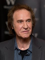 Ray Davies signs copies of his autobiography; 'Americana: The Kinks, The Riff, The Road' in London on Oct. 1, 2013.
