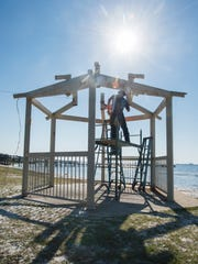 Mark Ceglarek, of Etheridge Construction, dismantles the rusting gazebos in preparation for new ones at Shoreline Park South in Gulf Breeze on Friday, March 23, 2018.
