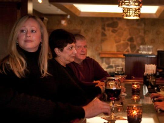 Patrons enjoy a drink at the bar at Charley Brown's.