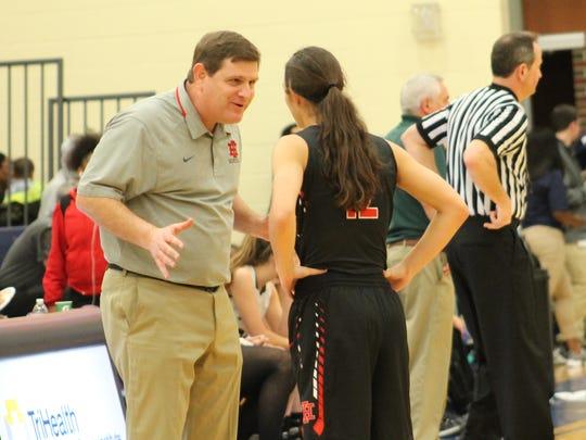 Indian Hill coach Chris Arington discusses the next play with senior Ellie Schaub.
