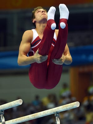 Alec Yoder of United States in action during the Parallel Bars Competition.
