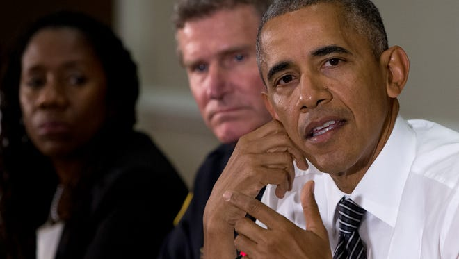 From left, Sherillyn Ifill, President and Director-Counsel of the NAACP Legal Defense and Educational Fund, and Terry Cunningham, President of the International Association of Chiefs of Police, look to President Barack Obama, right, as he speaks to media at the bottom of a meeting at the Eisenhower Executive Office Building on the White House complex in Washington, Wednesday, July 13, 2016, about community policing and criminal justice with a group made of activists, civil rights, faith, law enforcement and elected leaders.