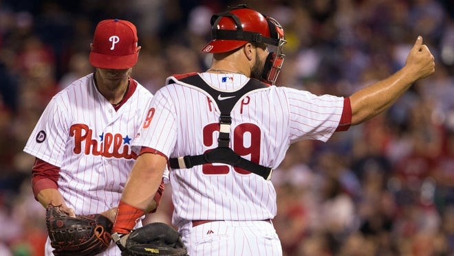 Philadelphia Phillies catcher Cameron Rupp signals for the trainer after starting pitcher Clay Buchholz is injured against the New York Mets.