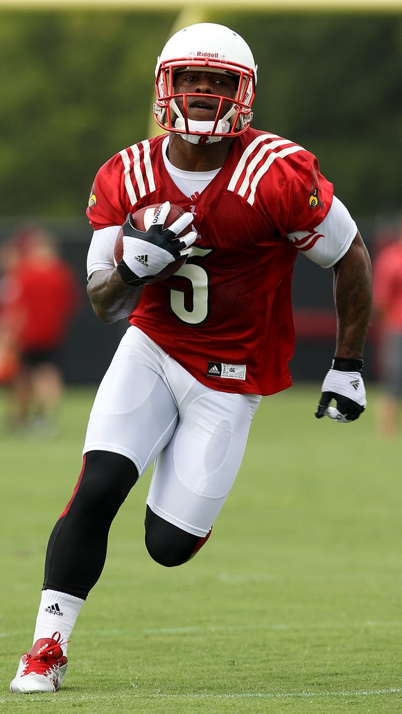Running back Michael Dyer runs a route during practice. August 5, 2014