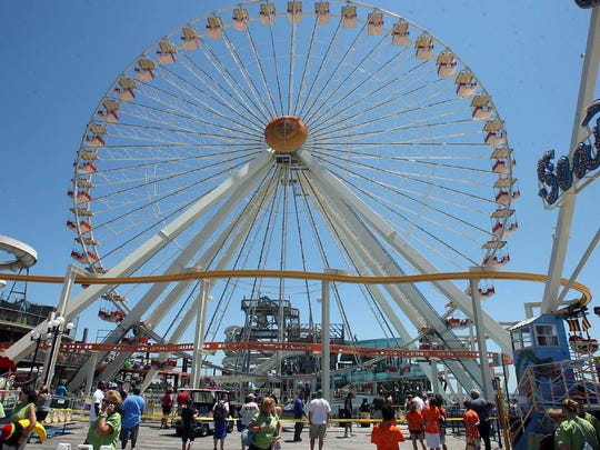 Spend the day at Morey's Piers on the Wildwood boardwalk and ride the Ferris wheel. ASSOCIATED PRESS