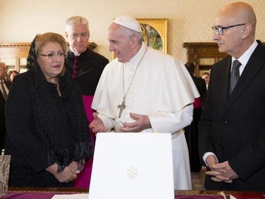 Pope Francis receives the President of Malta, Marie Louise Coleiro Preca, left, and her husband Edgar, right, during a private audience at the Vatican, Saturday, Dec. 17, 2016.