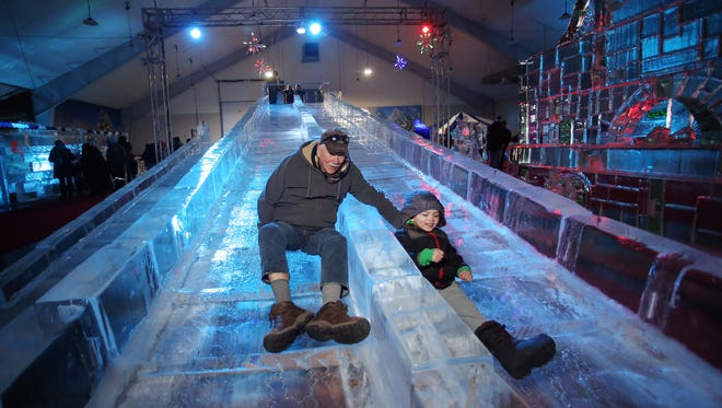 Mike Seymour and his grandson Camron Seymour, 4, of Lake Hopatcong take a ride together down the Natural Ice Slide at the frozen in Ice Carnival at the Skylands Stadium in Frankford is an ice sculpture extravaganza featuring more than 100 tons of ice sculptures, food, and entertainment. February 18, 2017, Frankford Township, NJ.