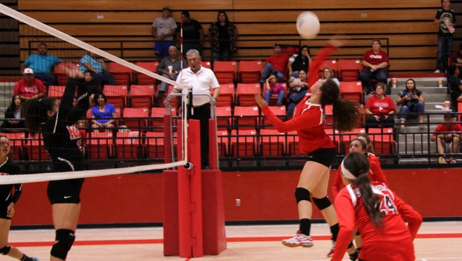Loving keeps the ball in play during the third set Tuesday against NMMI. The Lady Falcons won in straight sets.