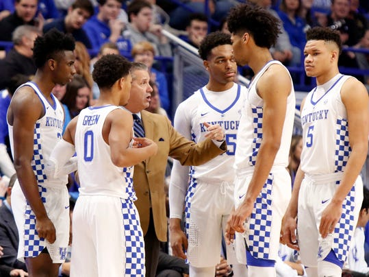 Kentucky head coach John Calipari, third from left, instructs, from left, Hamidou Diallo, Quade Green, Pj Washington, Nick Richards and Kevin Knox during the first half of an NCAA college basketball game, Wednesday, Nov. 22, 2017, in Lexington, Ky. (AP Photo/James Crisp)