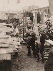 Immigrants at work in lumberyard in Burlington
