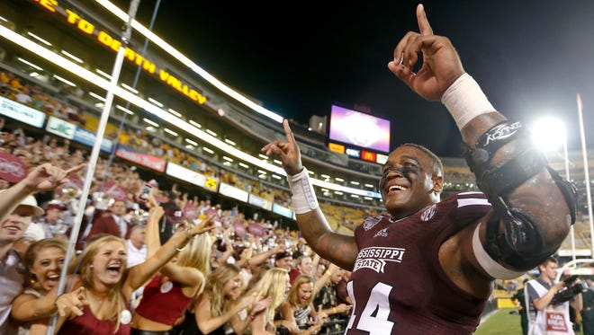 Mississippi State tight end Christian Holmes (44) celebrates with fans following a 34-29 win against LSU.