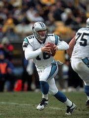 PITTSBURGH, PA - DECEMBER 15:  Quarterback Chris Weinke #16 of the Carolina Panthers drops back to pass during a game against the Pittsburgh Steelers at Heinz Field on December 15, 2002 in Pittsburgh, Pennsylvania.  The Steelers defeated the Panthers 30-14.  (Photo by George Gojkovich/Getty Images)