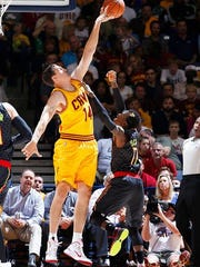 CINCINNATI, OH - OCTOBER 7: Sasha Kaun #14 of the Cleveland Cavaliers blocks a shot against Dennis Schroder #17 of the Atlanta Hawks during a preseason game at Cintas Center on October 7, 2015 in Cincinnati, Ohio. The Hawks defeated the Cavaliers 98-96. NOTE TO USER: User expressly acknowledges and agrees that, by downloading and or using the photograph, User is consenting to the terms and conditions of the Getty Images License Agreement. (Photo by Joe Robbins/Getty Images)