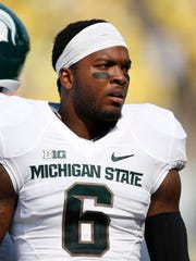 Former MSU defensive back Mylan Hicks, shown here against Oregon in 2014, was among the first in MSU's heralded 2010 recruiting class to commit to the Spartans. He was shot and killed Sunday in Calgary
