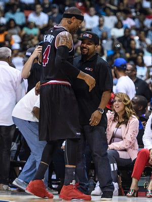 CHICAGO, IL - JULY 23: Trilogy captain Kenyon Martin (4) and Ice Cube talk after a Trilogy victory during a BIG3 Basketball game on July 23, 2017, at the UIC Pavilion in Chicago, IL.