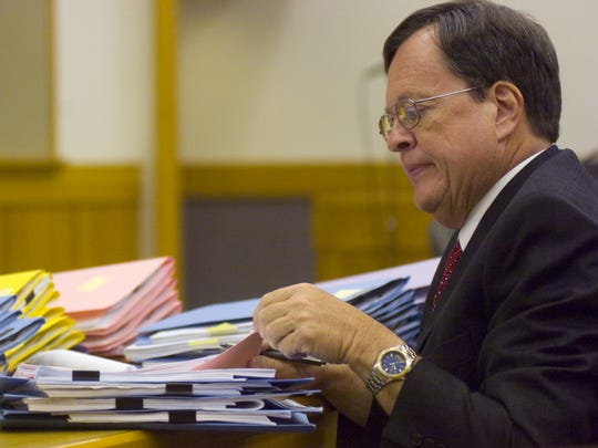 Attorney Robert Hill sorts foreclosure files during court with Judge James Thompson on Thursday, July 2, 2009, at the Lee County Justice Center in Fort Myers.