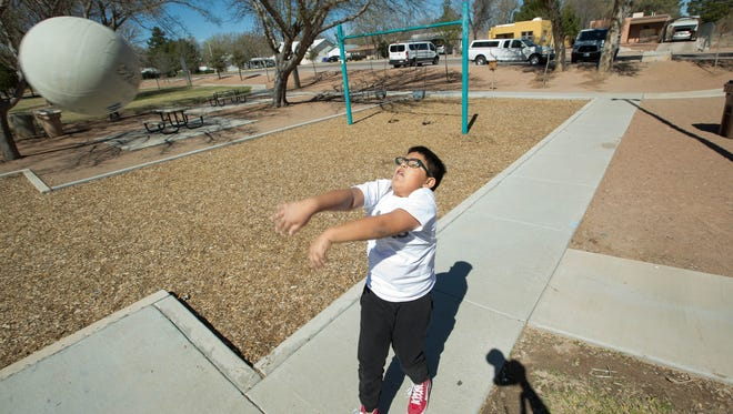 Miguel Segura, 11, hits a volleyball back to Spring Break Camp councilor Samantha Segovia, at Frank O'Brien Papen Community Center. The Spring Break Camp is offered by the city of Las Cruces and continues through Friday.