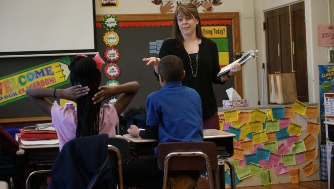 Carly Twilley, a prevention education specialist for  Prevent Child Abuse Delaware, teaches third graders at Harlan Elementary School about the signs of true neglect and child abuse during an in-classroom training sessions.