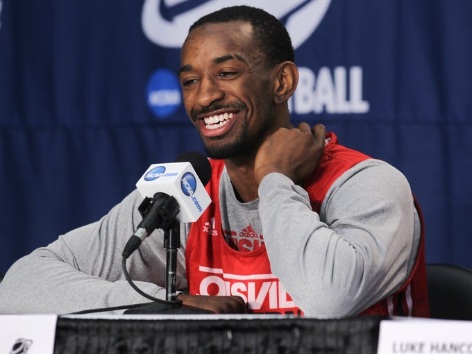 U of L's Russ Smith smiles as he answers a question during a press conference ahead of their NCAA matchup with Manhattan at the Amway Center in Orlando, Fl. Mar. 19, 2014