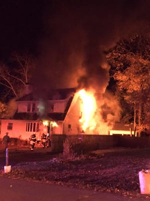 A fire rages at 17 Orchard St. in Hillcrest Monday, Nov. 14, 2016.