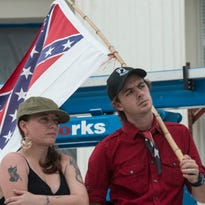 Preston Shearon, state leader of the Alabama Rangers, and Ashlee Kibbie, the group's secretary, stand with a Confederate flag in front of the Alabama Capitol. The Alabama Flaggers, a pro-Confederate battle flag group, held a rally Saturday, Aug. 29, 2015, in Montgomery to protest continued efforts to take down the flag. The Alabama Flaggers, a ÒSouthern heritageÓ organization, invited prominent members of the League of the South (LOS) to join them Saturday on the steps of the Alabama Capitol to demand secession from the United States.