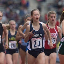 Randolph's Abby Loveys takes a handoff from team mate Nora May McSorley during High School Girls Large School 4X800 during Thursday events at the Penn Relays in Philadelphia, Pa. on April 28, 2016.