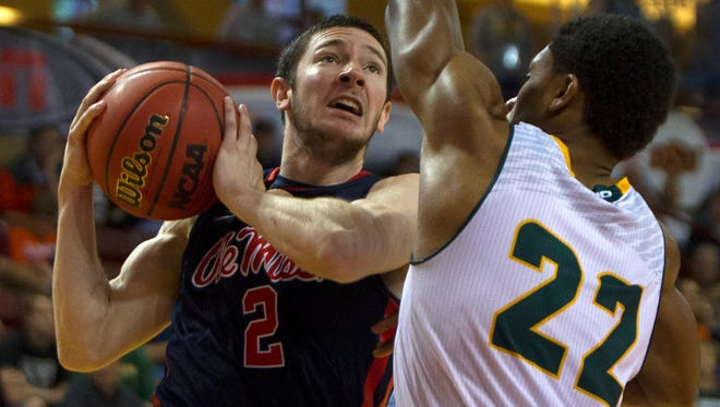 Former Ole Miss guard J.T. Escobar (2) goes in for the layup while being defended by George Mason guard Marquise Moore (22). Escobar described his transferring from Ole Miss as tough.