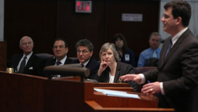 Attorneys from left, Edward Buzak, representing the New Jersey State League of Municipalities, Jeffrey Surenian representing the Borough of Atlantic Highlands, Jonathan Drill representing Bernards Township, and the state's Deputy Attorney General Geraldine Callahan, listen as Kevin Walsh, right, representing Fair Share Housing, addresses the state's Supreme Court, Tuesday, Jan. 6, 2015, in Trenton, N.J., regarding the state's affordable housing rules. Proponents say the courts need to step in because the Christie administration is overdue on delivering workable rules to comply with state law and past court decisions mandating that towns provide affordable housing for lower-income residents. (AP Photo/The Record of Bergen County, Chris Pedota, Pool)