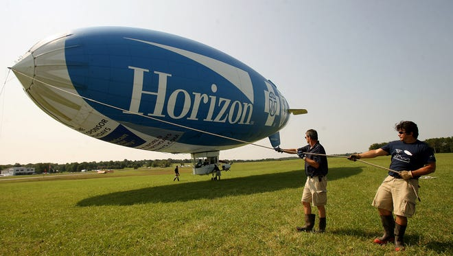 Crewman on the bow lines on the Horizon Blue Cross Blue Shield blimp at Solberg Airport in Readington in a 2009 file photo.