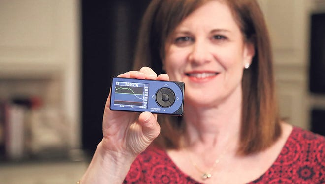 Lori Schur depends on her son's continuous glucose monitor to aid them in treating his juvenile diabetes.