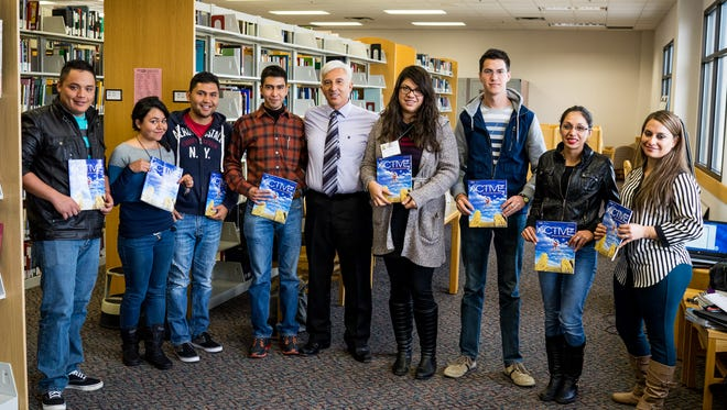 Program participants are pictured with Manuel Rodriguez, center, who is the director of the Language Institute.